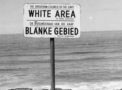 Apartheid is the reason for the whole South African disaster. No doubt: the apartheid policy is responsible for the racial tensions. The black race is excluded from a lot of places, e.g. at the bayside like indicated on this sign-post. (06/23/76)(AP PHOTO)